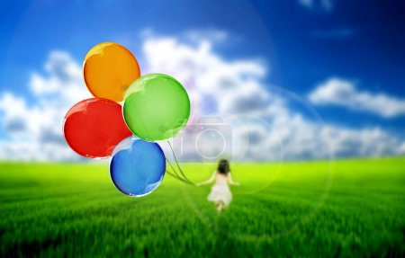 Photo for Child playing with balloons - Royalty Free Image