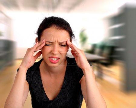 Woman heaving a headache