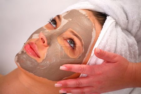 Spa clay mask on a woman's face