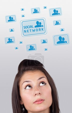 Young girl looking at social type of icons and signs