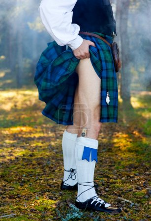 Photo for Legs of the man in kilt outdoor - Royalty Free Image