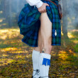 Legs of the man in kilt outdoor...