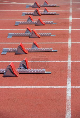 Photo for Athletics Starting Blocks on a red running track in the stadium. - Royalty Free Image