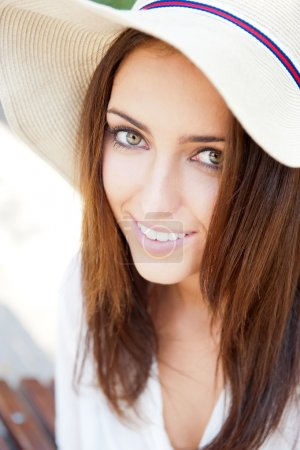 Beautiful young elegant woman wearing hat outdoor at park she is