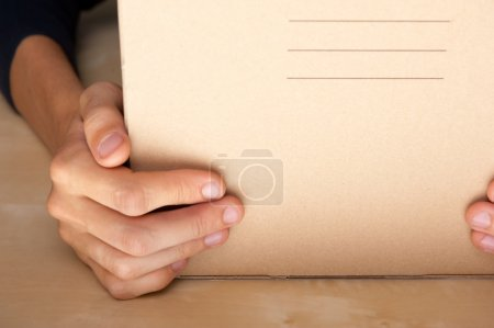 Successful Postal or delivery service concept. Man holding cardb