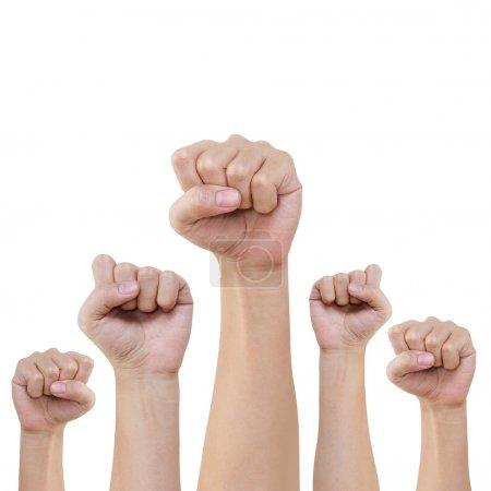 Photo pour Groupe de la main et fist lever haut sur fond blanc - image libre de droit