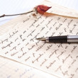 Love letter with a rose and pen...