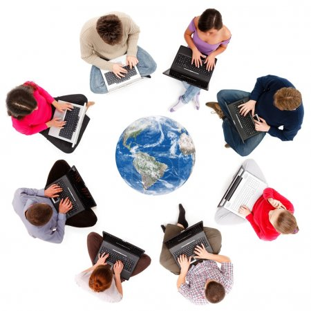 Photo for Social network members typing on laptop computers, seen from above - Royalty Free Image
