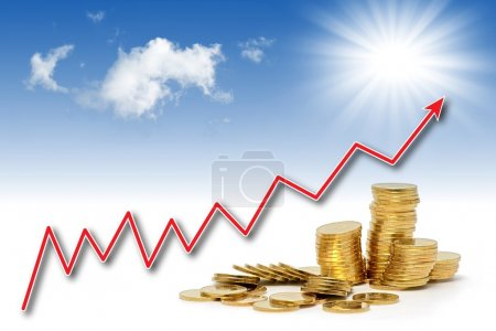 Photo for Stacks of golden coins under rising chart line and nice blue sky - Royalty Free Image