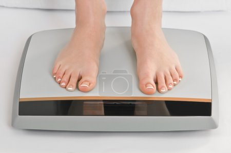 Photo for Women legs on electronic scales - Royalty Free Image