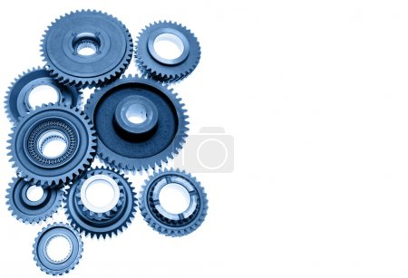 Steel gears meshing together on plain background