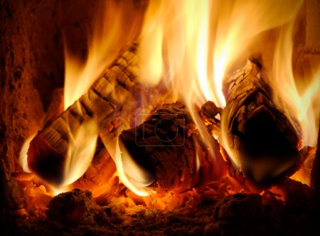Three burning billets in hot stove...