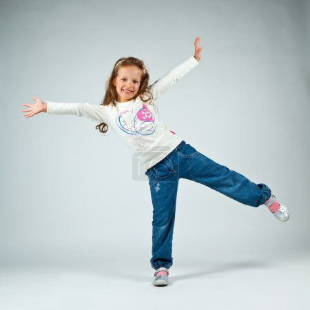 Photo for Little girl posing in studio - Royalty Free Image