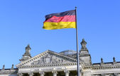 The German flag flying in front of the Reichstag in Berlin