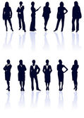 Set of dark blue vector business woman silhouettes with reflecti