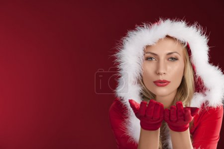 Photo for Portrait of cute sexy girl in red christmas dress with fur and gloves posing - Royalty Free Image