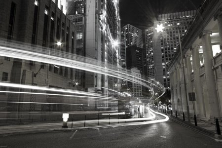 Photo for Traffic in city at night in black and white toned - Royalty Free Image