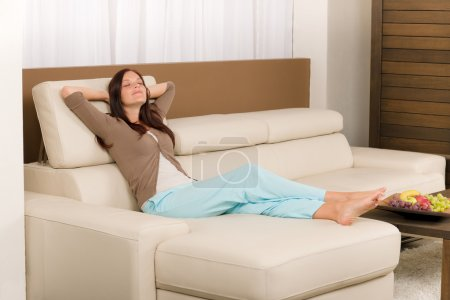 Photo for Attractive mid-aged woman relax modern living room on leather sofa - Royalty Free Image