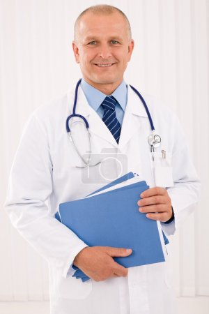 Mature doctor male portrait with folders