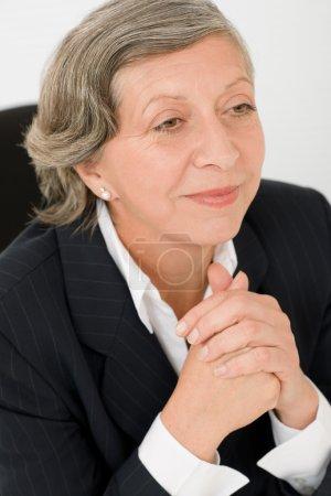 Senior businesswoman professional look aside