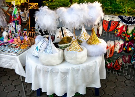 Kazakh ethnic hats and shoes with ornaments