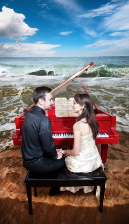 Couple near the piano on the beach