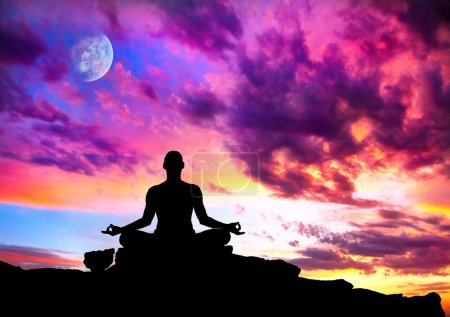 Photo for Yoga meditation in lotus pose by man silhouette with moon and purple dramatic sunset sky background. Free space for text and can be used as template for web-sit - Royalty Free Image