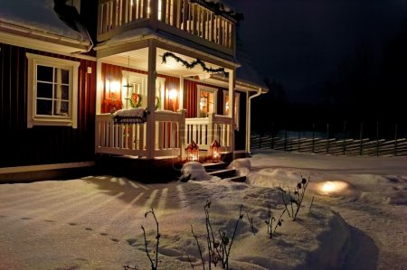 Christmas decorated house at night...