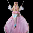 Pretty girl in fary-tale doll costume fly on wire...