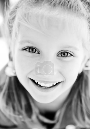 Beautiful little girl smiling. Black and white