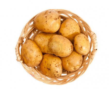 Photo for Potatoes in a wicker basket isolated on white background - Royalty Free Image