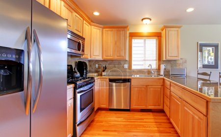 KItchen with maple cabinets and new stainless steal appliances.