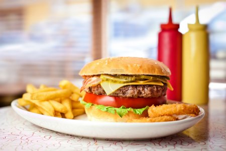 Photo for Close up of the fresh hamburger with french fries. - Royalty Free Image