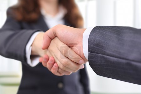 Photo for Clouse-up of businessman and businesswoman shaking hands - Royalty Free Image