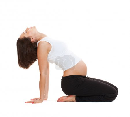 Pregnant woman doing gymnastic
