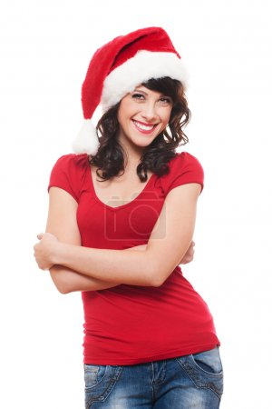 Cheerful young woman in red santa's hat