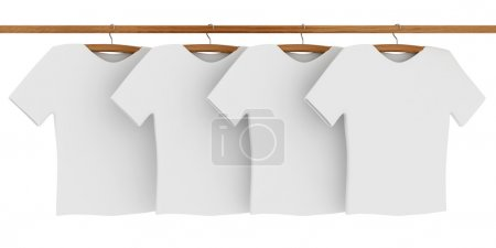 Photo for White T-shirts on Coat Hangers - Royalty Free Image