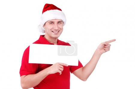 Happy man in Santa hat holding a blank board in front of him