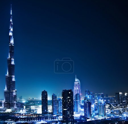 Photo for Dubai downtown night scene with city lights, luxury new high tech town in middle East, United Arab Emirates architecture - Royalty Free Image