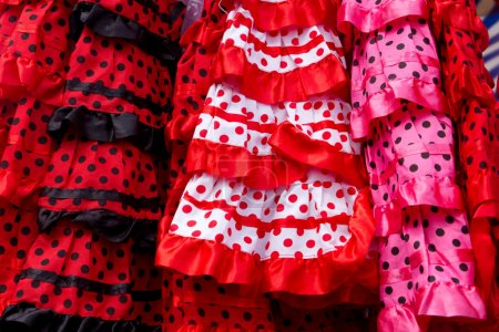 Photo for Colorful red pink gipsy costumes of flamenco dancer in andalusian - Royalty Free Image
