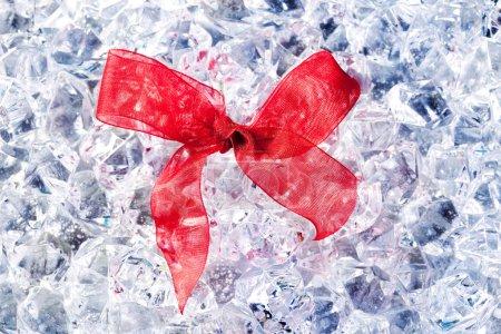 Christmas gift ribbon loop on winter ice