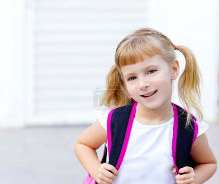 Children little girl going to school with bag