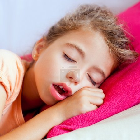 Photo for Deep sleeping children girl closeup portrait on pink pillow - Royalty Free Image