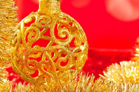 Christmas card golden bauble and tinsel