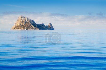 Ibiza Es Vedra island in calm blue water