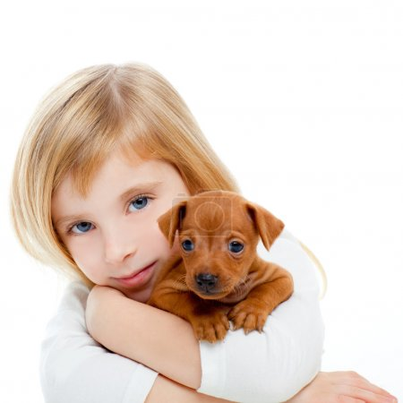Photo for Blond children girl with dog puppy mascot mini pinscher on white background - Royalty Free Image