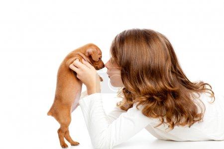 Brunette profile girl with dog puppy mini pinscher