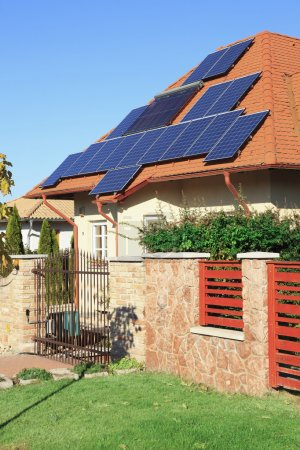 Solar power photovoltaic energy panels on tiled house roof