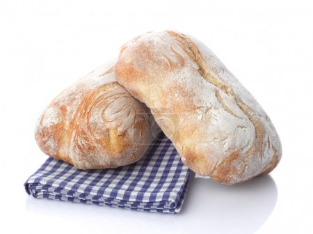 Photo for Fresh stack of warm french bread loaves on white background - Royalty Free Image
