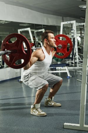 Photo for Man working out in gym - Royalty Free Image